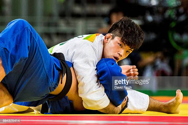 Double world champion Shohei Ono of Japan flips Miguel Murrillo of Costa Rica onto his side and then holds him for ippon on his way to the u73kg...