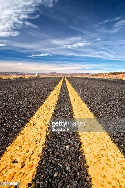 double yellow line on asphalt, arizona, usa - dividing line road marking stock photos and pictures