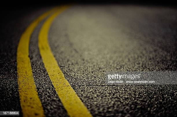 double yellow line on cracked asphalt - dividing line road marking stock pictures, royalty-free photos & images