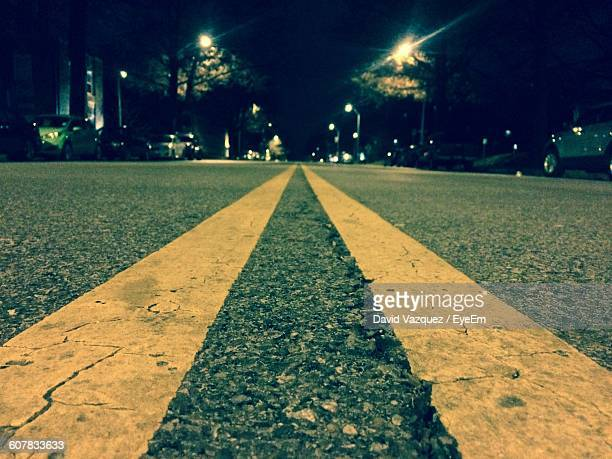 double yellow line on road at night - double yellow line stock photos and pictures