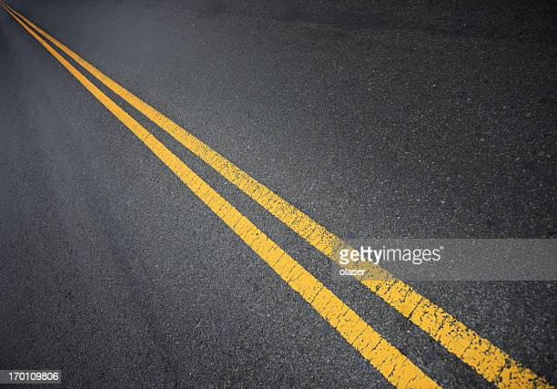 double yellow lines into infinity - dividing line road marking stock pictures, royalty-free photos & images