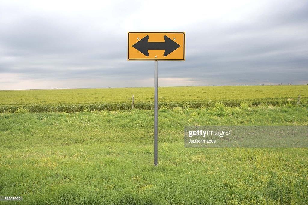 Double-arrow road sign : Stock Photo