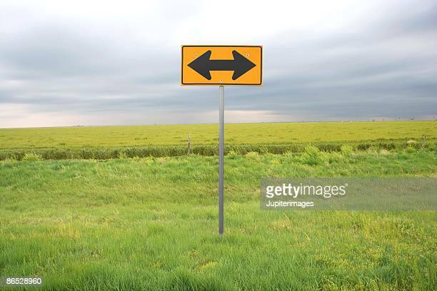 double-arrow road sign - double arrow stock pictures, royalty-free photos & images
