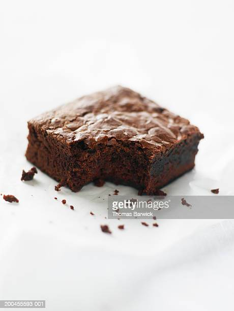 double-chocolate brownie missing one bite, elevated view - brownie stock pictures, royalty-free photos & images