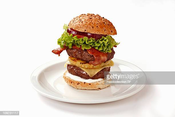 Double-decker burger with bacon and pineapple, close-up