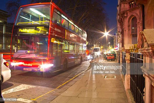 Double-decker bus in motion downtown London, England