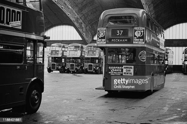Doubledecker buses at Stockwell Bus Garage south London 26th February 1967 In the foreground are two AEC Routemasters In the background are Leyland...