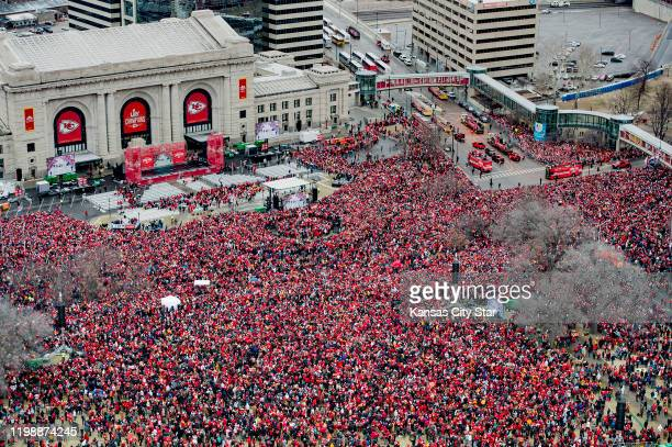 Doubledecker buses carrying members of the Kansas City Chiefs roll down toward Union Station during the Kansas City Chiefs Super Bowl victory parade...