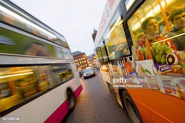 double-decker busses in belfast - donegall square stock pictures, royalty-free photos & images