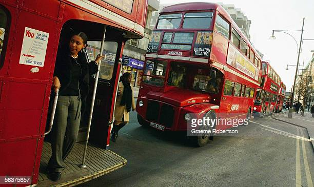 Double-decker Routemaster bus makes its way through the streets March 2, 2004 in London, England. The vehicles with their conductors and trademark...