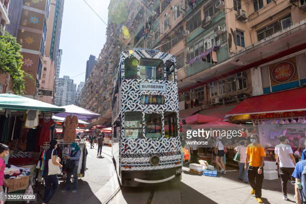 double-decker tram at chun yeung street market in north point, hong kong - area designer label stock pictures, royalty-free photos & images