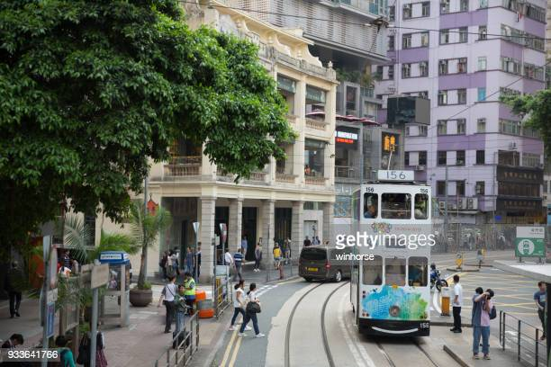 double-decker trams in hong kong - wanchai stock photos and pictures