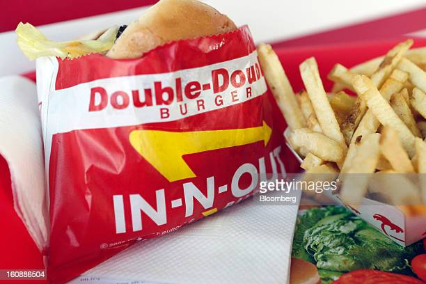 A DoubleDouble burger and french fries are arranged for a photograph at an InNOut Burger restaurant in Costa Mesa California US on Wednesday Feb 6...