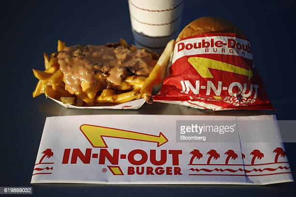 A DoubleDouble Cheeseburger Combo with Animal Style French Fries is arranged for a photograph at an InNOut Burger restaurant in Fort Worth Texas US...