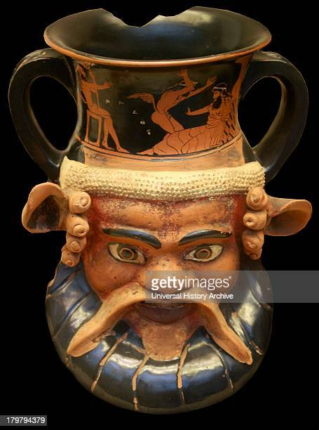 Doubleheaded redfigured drinking cup also known as a 'Kantharos' Greek made in Athens circa 470 BC The heads are backtoback representing a satyr and...