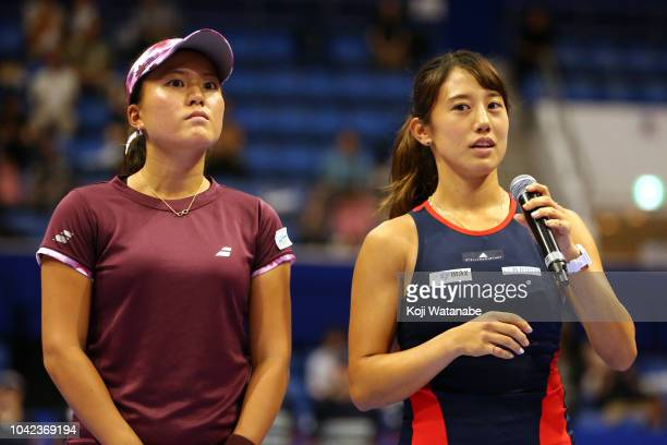 Doubles champion Makoto Ninomiya and Miyu Kato of Japan applaud fans during the ceremony after the Doubles final against Barbora Strycova and Andrea...