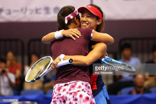 Doubles champion Makoto Ninomiya and Miyu Kato of Japan celebrate after the Doubles final against Barbora Strycova and Andrea Sestini Hlavackova of...