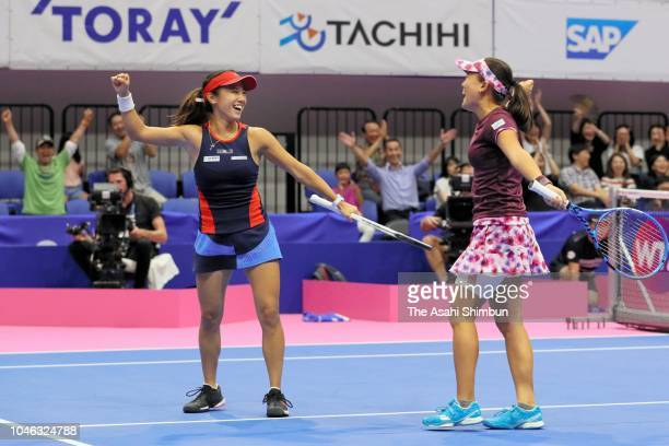 Doubles champion Makoto Ninomiya and Miyu Kato of Japan celebrate their victory in the Doubles final against Barbora Strycova and Andrea Sestini...