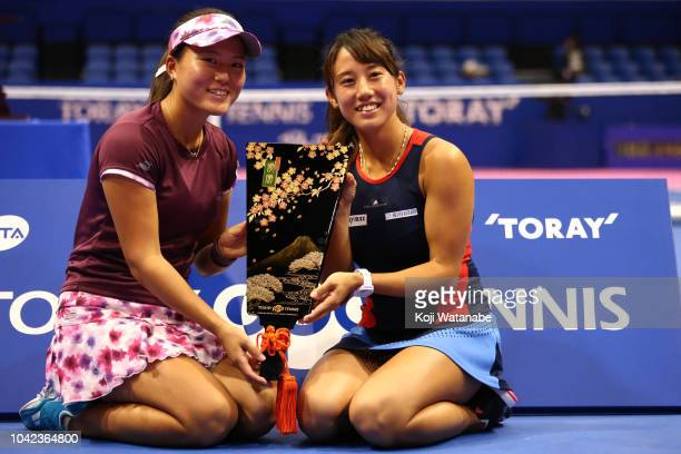 Doubles champion Makoto Ninomiya and Miyu Kato of Japan pose for photographs after the Doubles final against Barbora Strycova and Andrea Sestini...