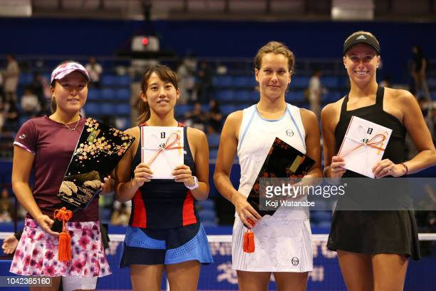 Doubles champion Makoto Ninomiya and Miyu Kato of Japan runnersup Barbora Strycova and Andrea Sestini Hlavackova of the Czech Republic pose for...