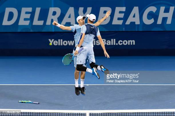 Doubles match winners Bob and Mike Bryan of the USA chest bump during their match against Kevin Krawietz and Andreas Mies of Germany at the Delray...