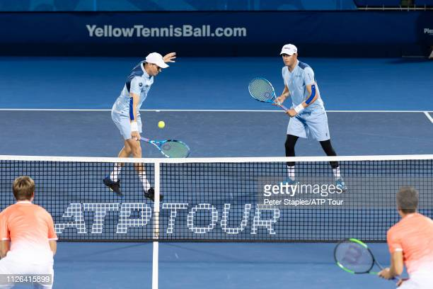 Doubles match winners Bob and Mike Bryan of the USA in action at the net against Kevin Krawietz and Andreas Mies of Germany at the Delray Beach Open...