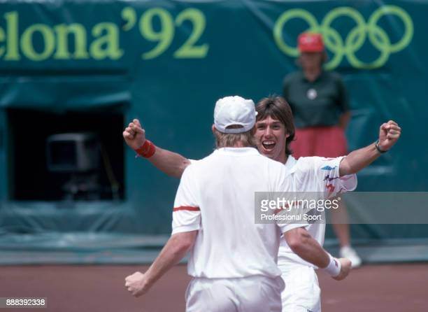 Doubles partners Boris Becker and Michael Stich of Germany celebrate after defeating Wayne Ferreira and Piet Norval of South Africa in the Men's...