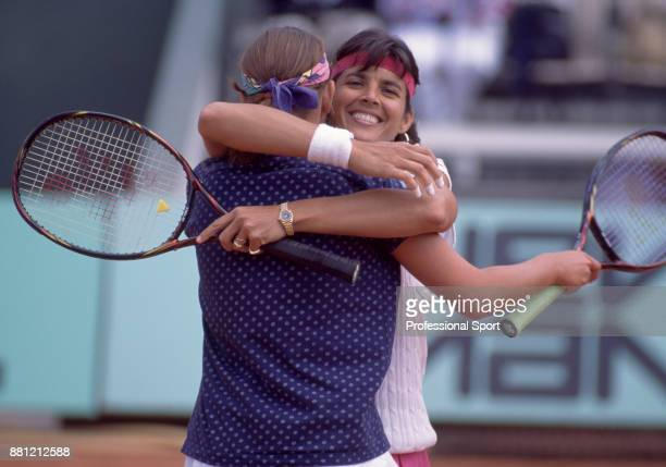 Doubles partners Gigi Fernandez of the USA and Natasha Zvereva of Belarus celebrate with a hug during the French Open Tennis Championships at the...