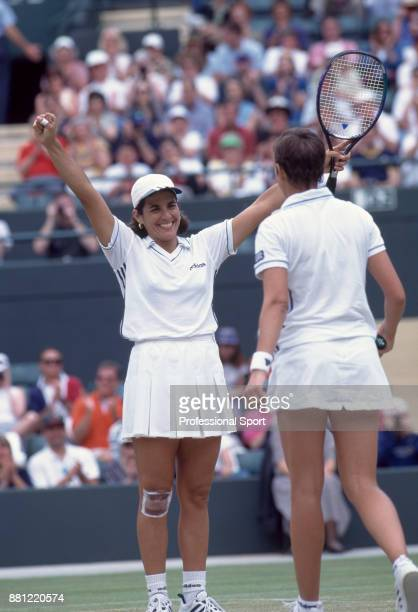 Doubles partners Gigi Fernandez of the USA and Natasha Zvereva of Belarus celebrate after defeating Nicole Arendt of the USA and Manon Bollegraf of...