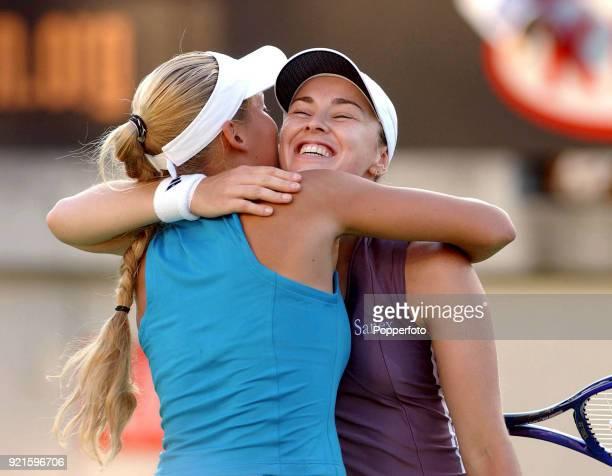 Doubles partners Martina Hingis of Switzerland and Anna Kournikova of Russia after defeating Daniela Hantuchova of Slovakia and Arantxa Sanchez...