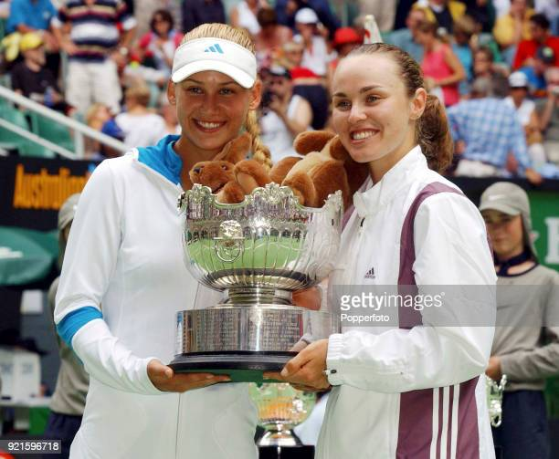 Doubles partners Martina Hingis of Switzerland and Anna Kournikova of Russia celebrate with the trophy after defeating Daniela Hantuchova of Slovakia...