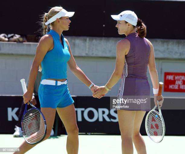 Doubles partners Martina Hingis of Switzerland and Anna Kournikova of Russia enroute to defeating Daniela Hantuchova of Slovakia and Arantxa Sanchez...