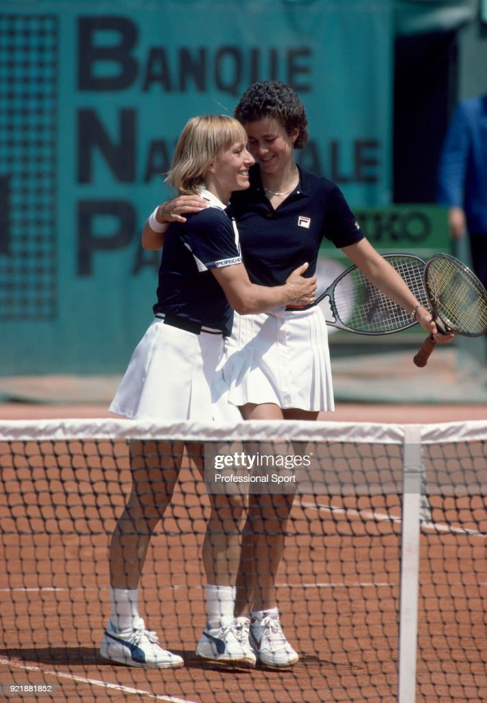Doubles partners Martina Navratilova (left) and Pam Shriver of the USA hug during the French Open Tennis Championships at the Stade Roland Garros circa May 1984 in Paris, France.