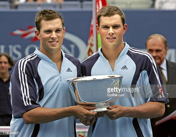 Doubles team the Bryan Brothers, Mike and Bob , pose with cup after their win of the U.S. Open Men's Doubles title, defeating Bjorkman and Mirnyi...