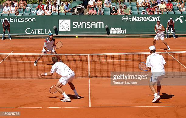 Doubles teammates Jonas Björkman and Thomas Johansson of Sweden during their match against Jose Acasuso and Juan Ignacio from Argentina in the 2006...