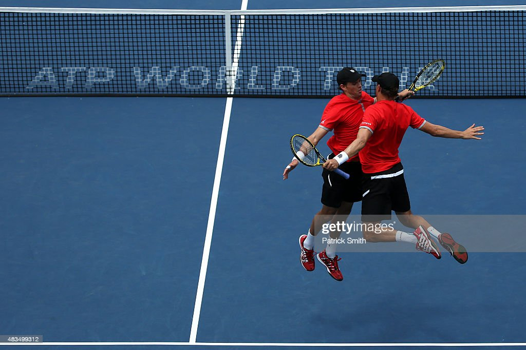 Doubles teammates Mike Bryan (L) and Bob Bryan celebrate after defeating Ivan Dodig of Croatia and Marcelo Melo of Brazil in the men's double final during the Citi Open at Rock Creek Park Tennis Center on August 9, 2015 in Washington, DC.