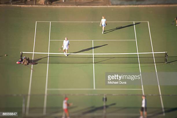 doubles tennis aerial view on public courts