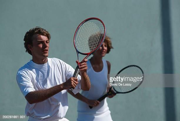 Doubles tennis match, focus on man