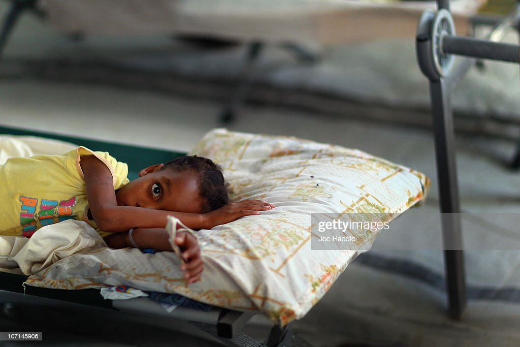 Doudelime Lamarre, 7, lays on her cot as she is being treated for cholera in an International Red Cross cholera treatment facility in the slum neighborhood of Cite Soleil on November 25, 2010 in Port-au-Prince, Haiti. Haiti continues to deal with a cholera epidemic that has killed more than 1,400 with thousands more sick. Doctors say it is caused by poor sanitary conditions that make the bacteria easy to transmit through contaminated water or food.