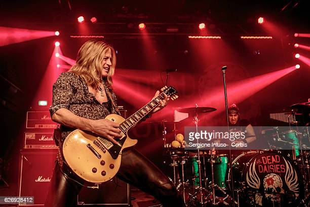 Doug Aldrich of AustralianAmerican rock band and musical collective The Dead Daisies performs on stage on November 29 2016 in Milan Italy