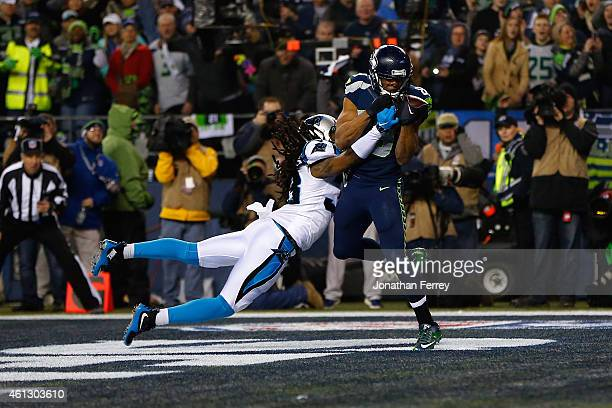 Doug Baldwin of the Seattle Seahawks catches a 16 yard touchdown pass from Russell Wilson in the first quarter against the Carolina Panthers during...