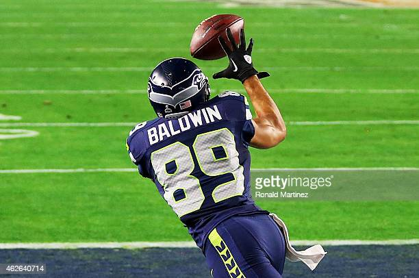 Doug Baldwin of the Seattle Seahawks catches a three yard touchdown pass against the New England Patriots in the third quater during Super Bowl XLIX...