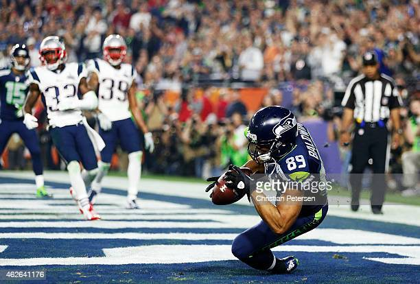 Doug Baldwin of the Seattle Seahawks catches a three yard touchdown pass against the New England Patriots in the third quarter during Super Bowl XLIX...