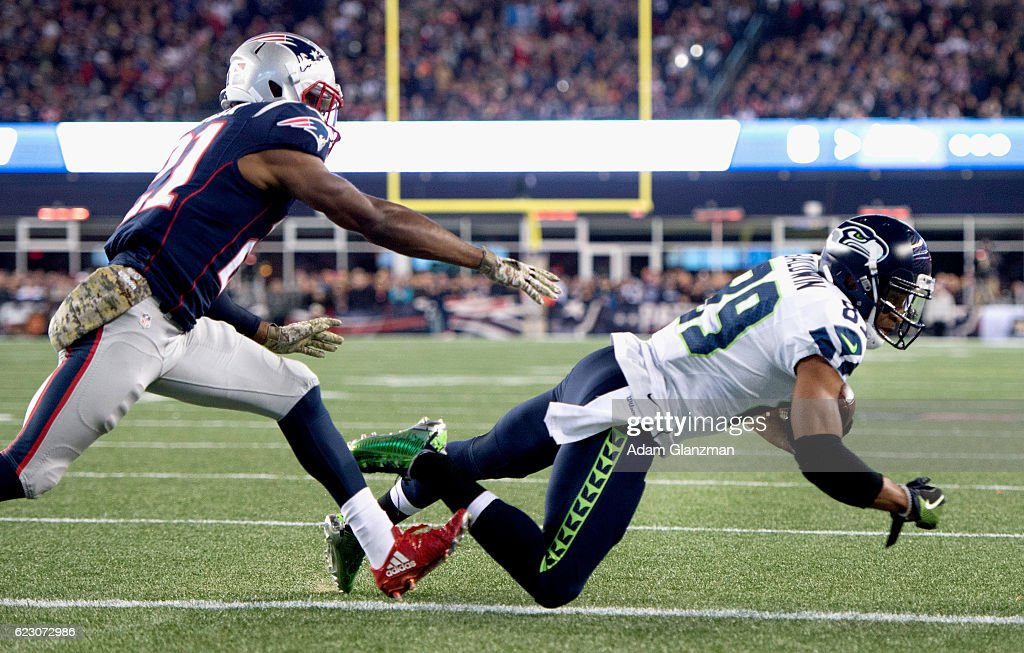 Doug Baldwin #89 of the Seattle Seahawks catches a touchdown pass as he is defended by Malcolm Butler #21 of the New England Patriots during the second quarter of a game at Gillette Stadium on November 13, 2016 in Foxboro, Massachusetts.