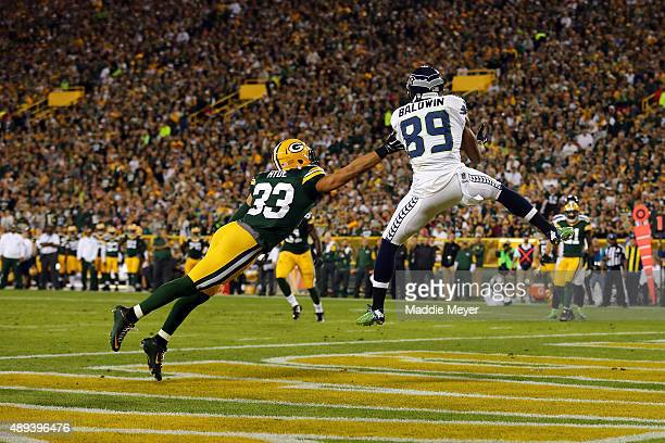 Doug Baldwin of the Seattle Seahawks catches a touchdown pass from Russell Wilson in the third quarter against the Green Bay Packers during their...