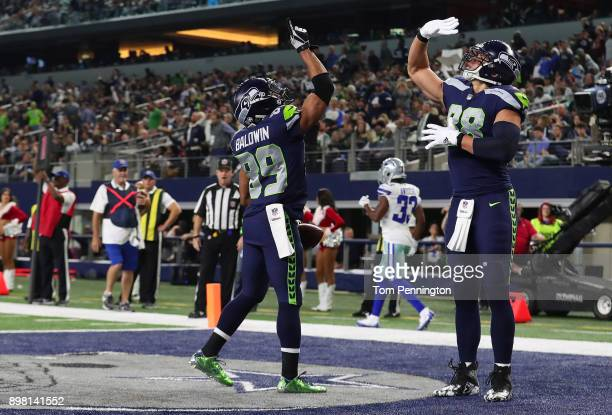 Doug Baldwin of the Seattle Seahawks celebrates a fourth quarter touchow with Jimmy Graham of the Seattle Seahawks against the Dallas Cowboys at ATT...