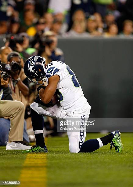 Doug Baldwin of the Seattle Seahawks celebrates after catching a touchdown pass from Russell Wilson in the third quarter against the Green Bay...