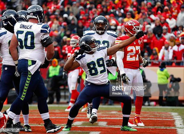 Doug Baldwin of the Seattle Seahawks celebrates scoring a touchdown against the Kansas City Chiefs during the first half at Arrowhead Stadium on...