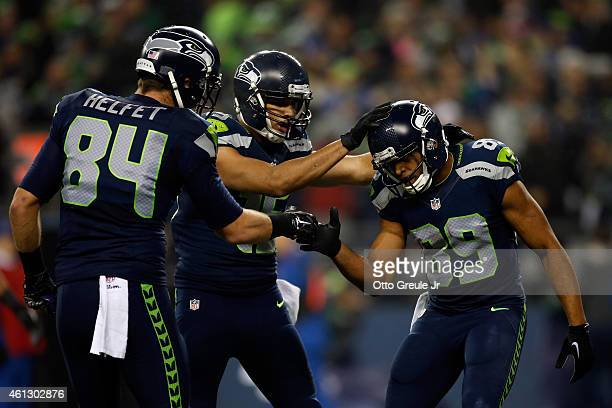 Doug Baldwin of the Seattle Seahawks celebrates with Cooper Helfet and Jermaine Kearse after catching a 16 yard touchdown pass from Russell Wilson in...