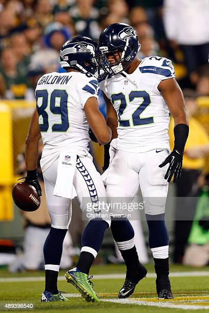 Doug Baldwin of the Seattle Seahawks celebrates with teammate Fred Jackson after catching a touchdown pass from Russell Wilson in the third quarter...